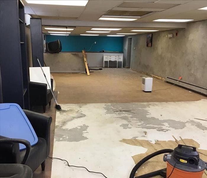 Water damaged commercial building with wet drywall throughout the entire basement